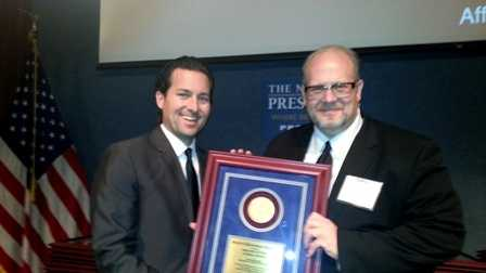 Reporter Travers Mackel and Executive Producer Keith Bliven accept the Sigma Delta Chi Award on behalf of WDSU TV.