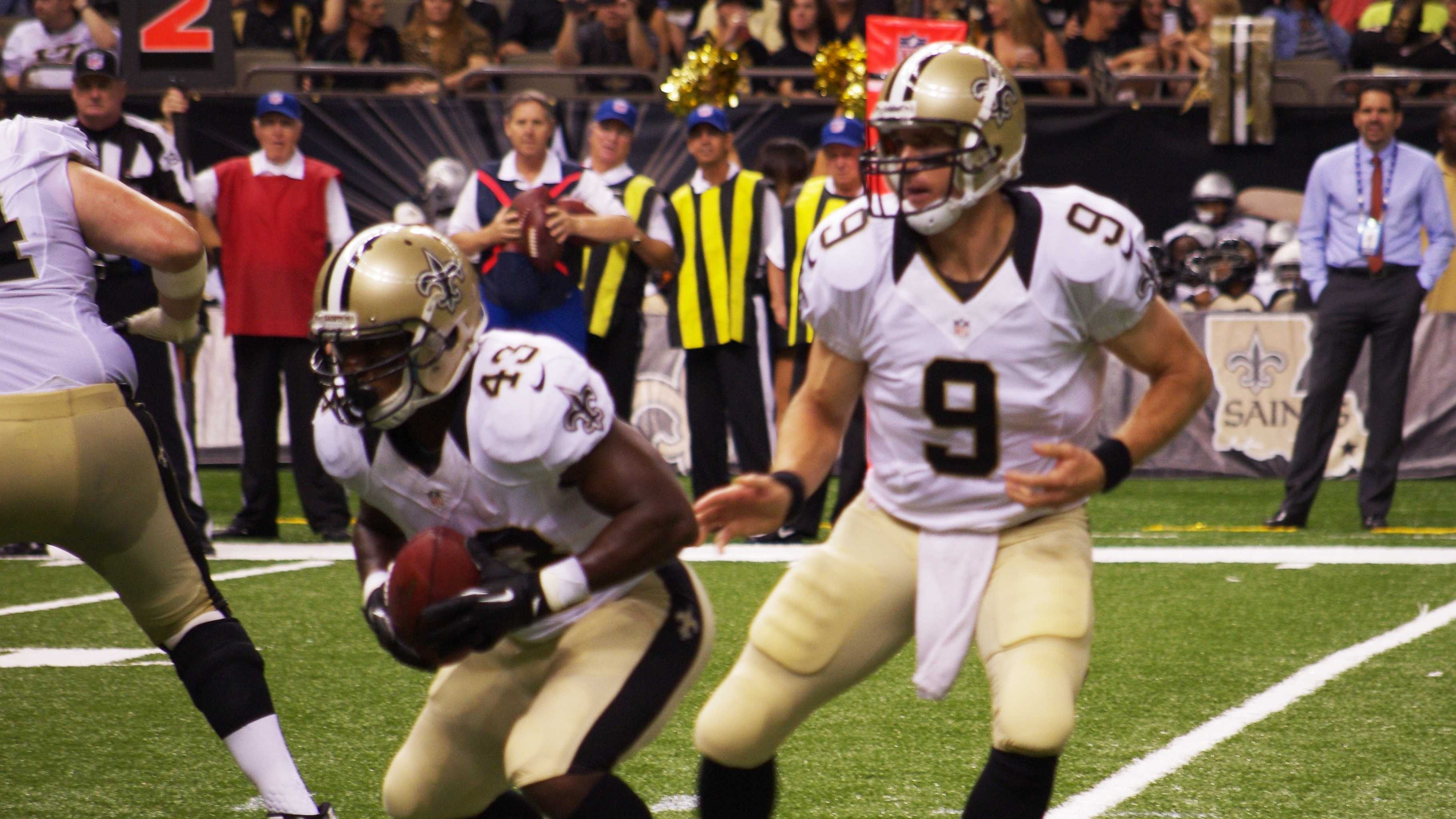 Drew Brees hands the ball to Darren Sproles in the second quarter of the Saints' pre-season win over the Oakland Raiders.