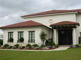 Gardner Realtors shows this Mediterranean style home in the English Turn subdivision in this week's Mansion Monday Slideshow. The home is at 107 English Turn Drive in New Orleans and is listed at $900,000. For more information contact them by email at info@gardnerrealtors.com or by phone: 800-566-7801.