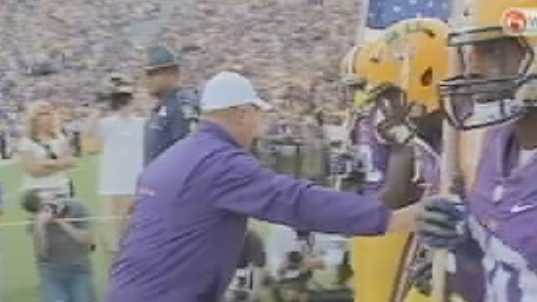 Les Miles leads LSU out.jpg