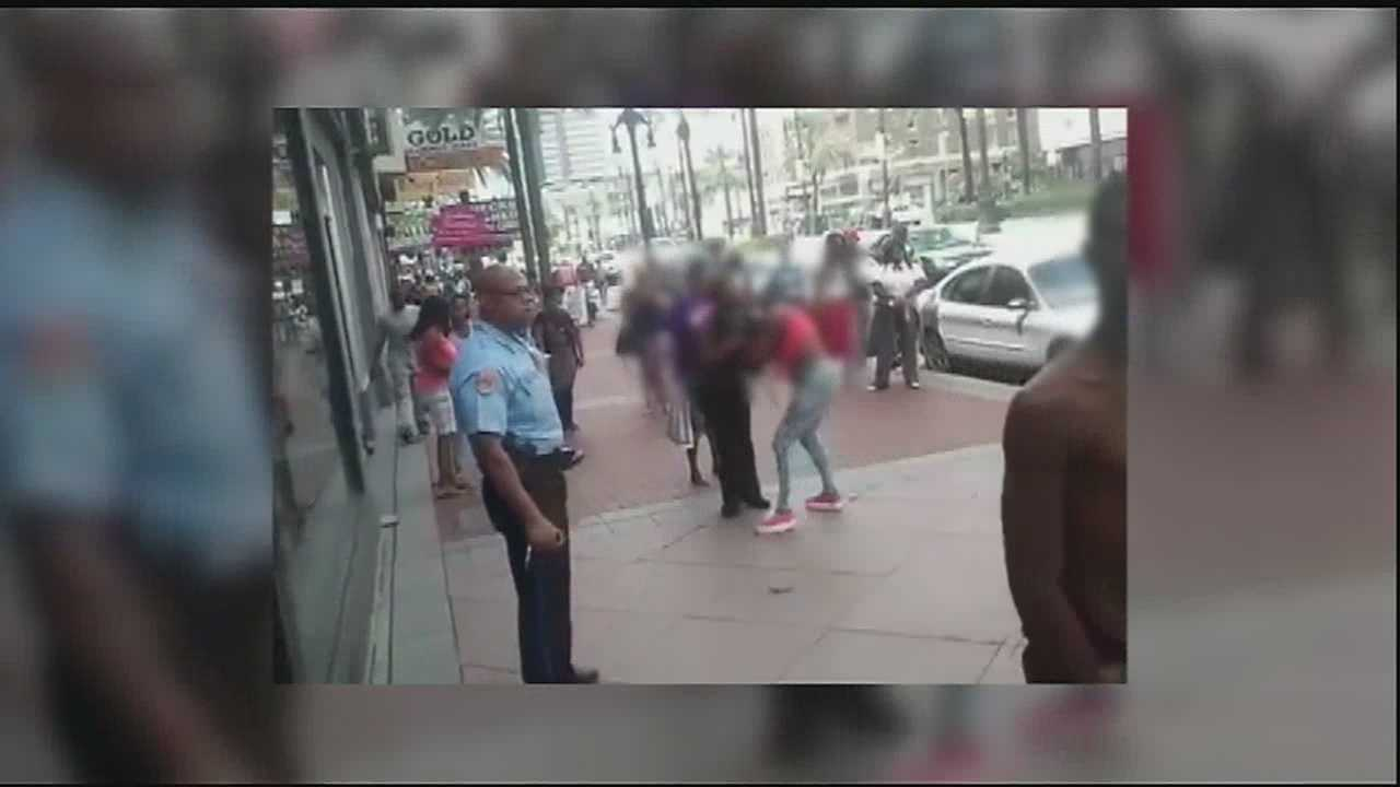 The New Orleans Police Department suspended an officer on Wednesday after a video posted to YouTube shows the officer doing nothing to stop a fight between two girls and man.