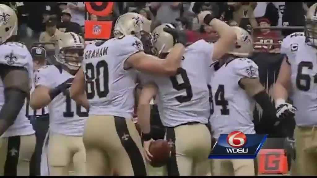 Graham Brees and team celebrate touchdown