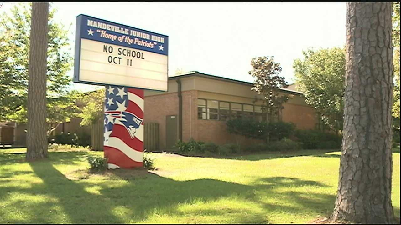 A 13-year-old 7th grader and a 14-year-old 8th grader at Mandeville Junior High School have been booked with possession of a firearm on school property.