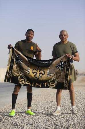 Gunnery Sgt. Morris Mayfield (left) and Master Sgt. Marcelino Marquez, Jr., Marines with Combat Logistics Regiment 2, Regional Command (Southwest), pose for a picture after their half marathon at Camp Leatherneck, Helmand province, Afghanistan, Oct. 10, 2013.