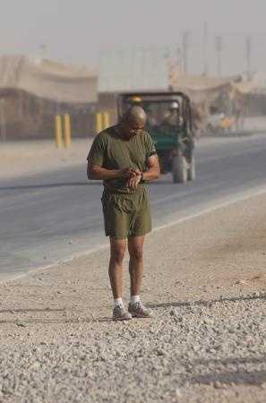 Master Sgt. Marcelino Marquez, Jr., a Marine with Combat Logistics Regiment 2, Regional Command (Southwest), checks his run time at the end of a half marathon at Camp Leatherneck, Helmand province, Afghanistan, Oct. 10, 2013.