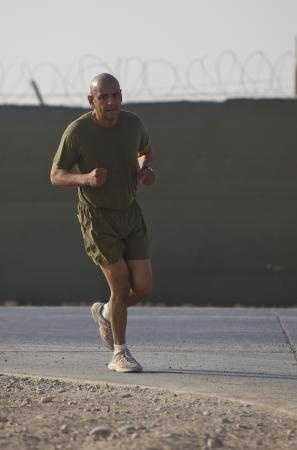 Master Sgt. Marcelino Marquez, Jr., a Marine with Combat Logistics Regiment 2, Regional Command (Southwest), runs a half marathon at Camp Leatherneck, Helmand province, Afghanistan, Oct. 10, 2013.