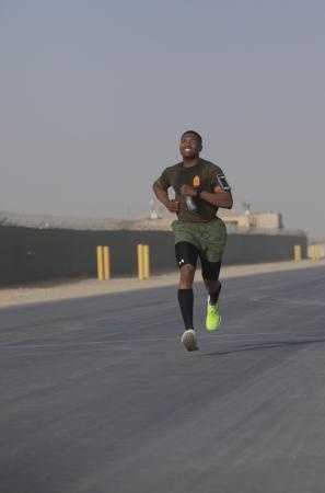 Gunnery Sgt. Morris Mayfield, a New Orleans native and facilities and mess chief for Combat Logistics Regiment 2, Regional Command (Southwest), runs a half marathon at Camp Leatherneck, Helmand province, Afghanistan, Oct. 10, 2013.