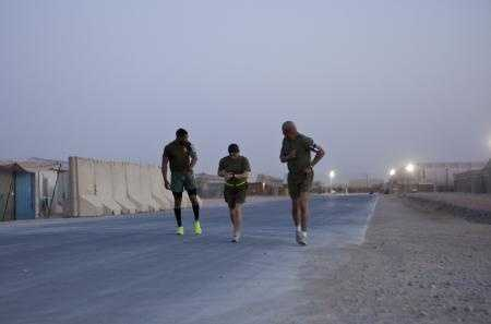 Marines with Combat Logistics Regiment 2, Regional Command (Southwest), take off at the start of a half marathon at Camp Leatherneck, Helmand province, Afghanistan, Oct. 10, 2013.
