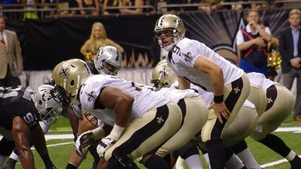 Saints Offensive Line Superdome White jerseys Gold Pants.jpg