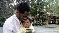 Deshawn Butler hold his son Deshawn Kinard in a photo given to WDSU by family members.