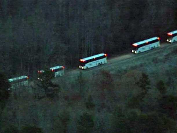 The tour buses arrived just after sunrise after 7 a.m.