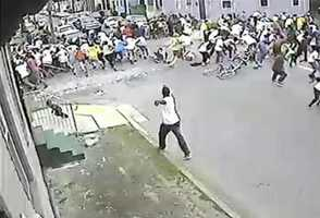May 2013: The New Orleans Police Department released surveillance video of a shooting that happened during a second line on Mother's Day. The video shows a man approaching a large crowd and firing numerous shots, then leaving the scene. Police arrested two men in the shooting -- Akein Scott and his brother Shawn Scott. They face multiple attempted murder charges. Nineteen people were shot during the second line parade in the 7th Ward. Read the story