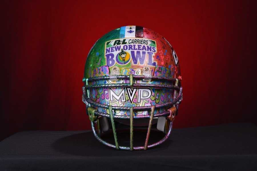 """""""The key to this year's concept was being able to incorporate both teams' logos, their helmet decals, into the design of this helmet,"""" Seither said. """"Being a Ragin' Cajun alum and already having a relationship with the Tulane Football program, I was lucky to have both teams' cooperation."""""""