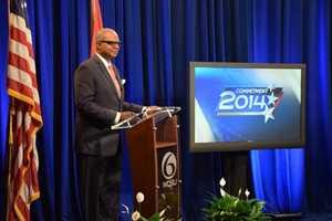 Norman Robinson moderates the 2014 Council at Large debates.