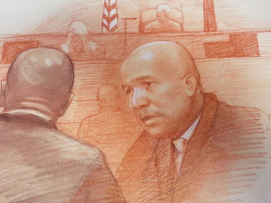 Nagin and attorney talk to one another during trial
