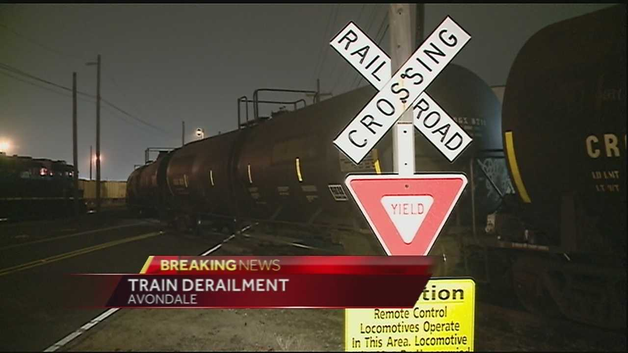 Officials closed River Road in both directions Tuesday morning after a train derailed in Avondale.
