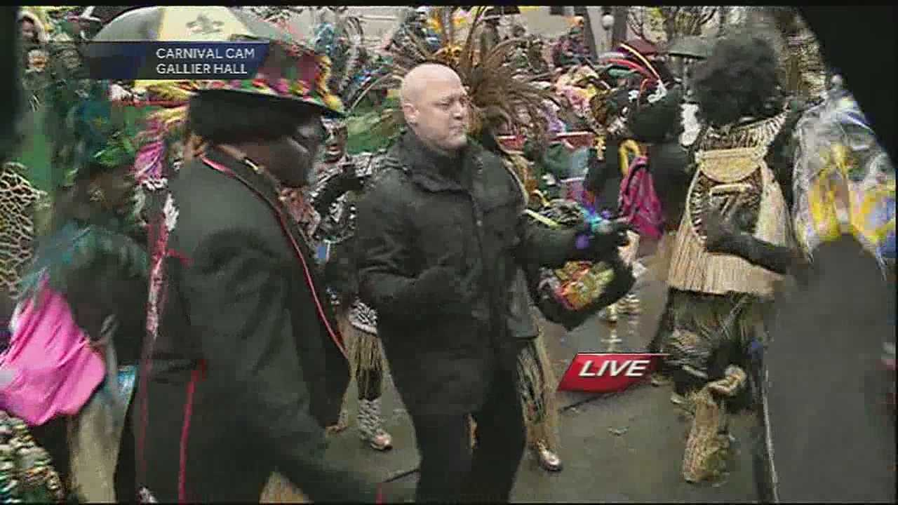 The mayor has some fun on Mardi Gras day near Gallier hall as an honorary member of the Walking Warriors.