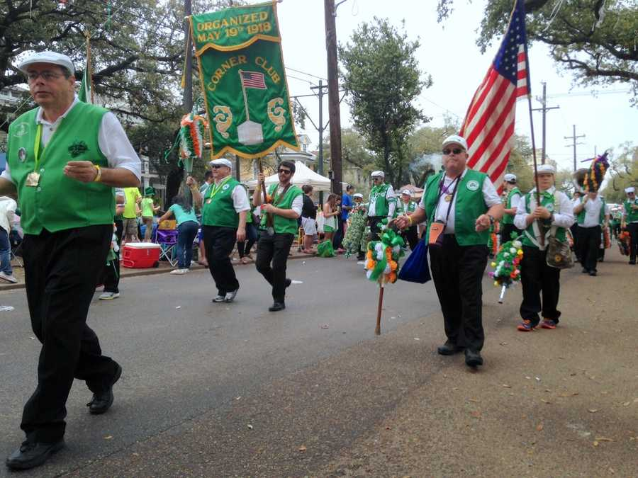 The Irish Channel parade features marching organizations who will often trade a flower for a kiss on the street.