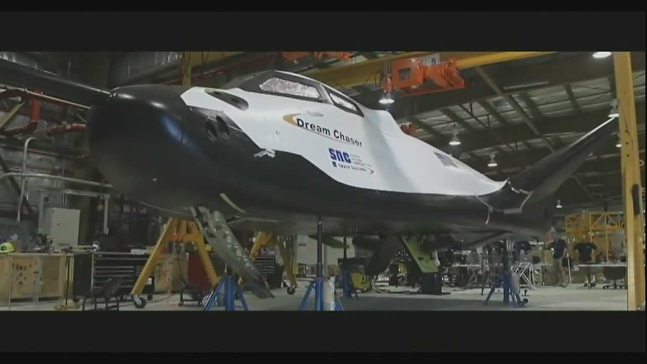Executives with Lockheed Martin and Sierra Nevada Space Systems gave the media a look at the beginning stages of the Dream Chaser spacecraft being constructed at the site. It is one of three being built to shuttle astronauts to and from the International Space Station (ISS).
