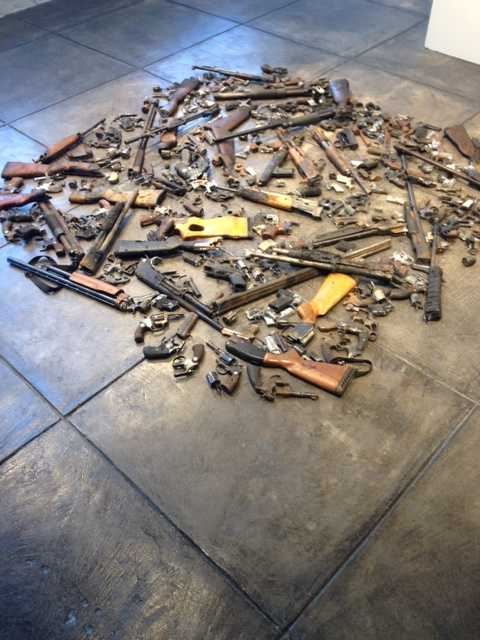 """City officials and civic leaders gathered Wednesday at the Jonathan Ferrara Gallery to announce a project called """"Guns in the Hands of Artists."""""""