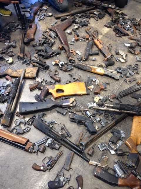 On the floor of the gallery were parts of 186 guns removed from the streets of New Orleans through the city police department's gun buyback program.