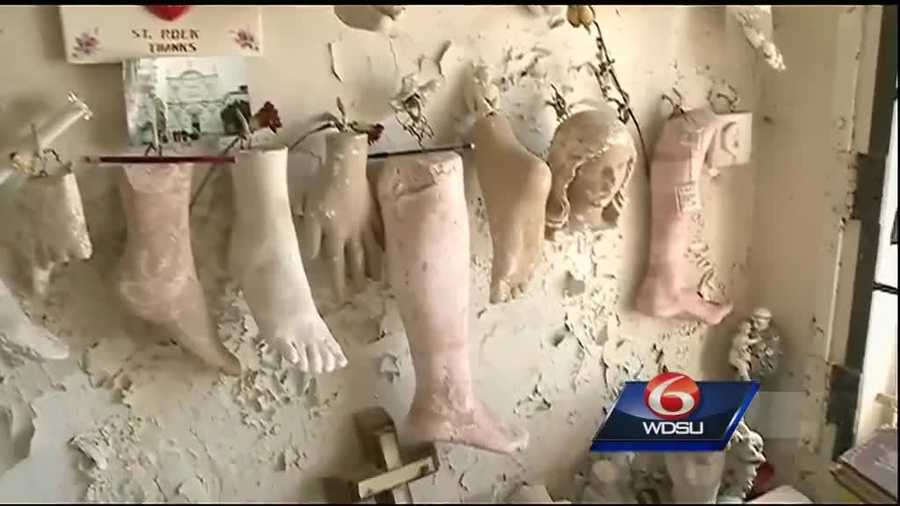 It's crowded with plaster replicas of body limbs. Hanging all over the walls, are ceramic replicas of legs, a heart, a hand and feet.