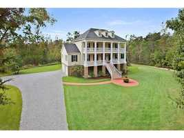 Stately Houmas House look alike located on 3.3 peaceful, wooded acres in gated community is featured in this week's Mansion Monday slideshow. The home is located at 212 Mattingly Lane in St. Tammany Parish and is listed at $975,000. Contact Gardner Realtors for more information - info@gardnerrealtors.com or by phone: 800-566-7801.