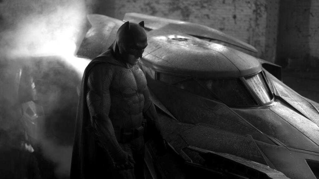 "Zack Snyder, director of the upcoming ""Man of Steel"" sequel, tweeted a photo of Ben Affleck in the full Batman costume standing next to the redesigned Batmobile for the 2016 film."
