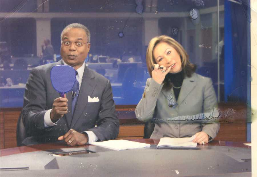 Early/Mid-2000s: Norman and Kriss clowning around at the anchor desk.