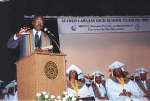 1999: Norman as a commencement speaker at Alfred Lawless High School.