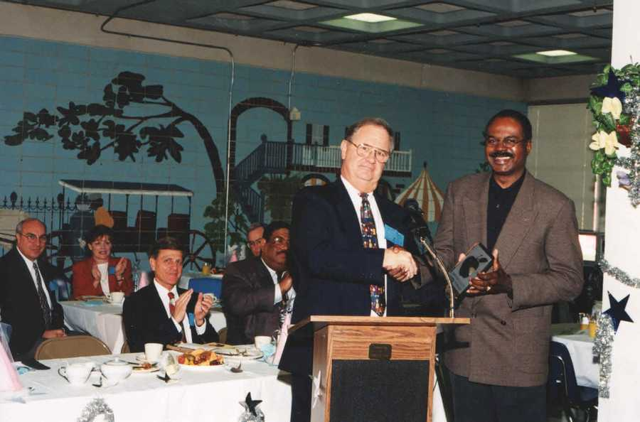 1996: Norman at an education ceremony breakfast with Elton Lagasse in Jefferson Parish.