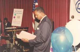 Mid-1990s Norman MCing South Central Bell Community Awards ceremony.