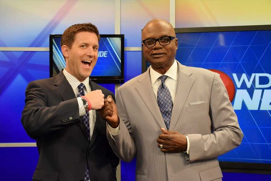 Norman and Scott do a traditional fist-bump before a newscast.