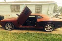 A fight ensued and another man approached the driver's side of the vehicle -- a red 2010 Dodge Challenger with black flames across the sides and a Louisiana license plate VOV253 -- and pointed a handgun at the victim, demanding he to get out of the car. The victim complied, police said.