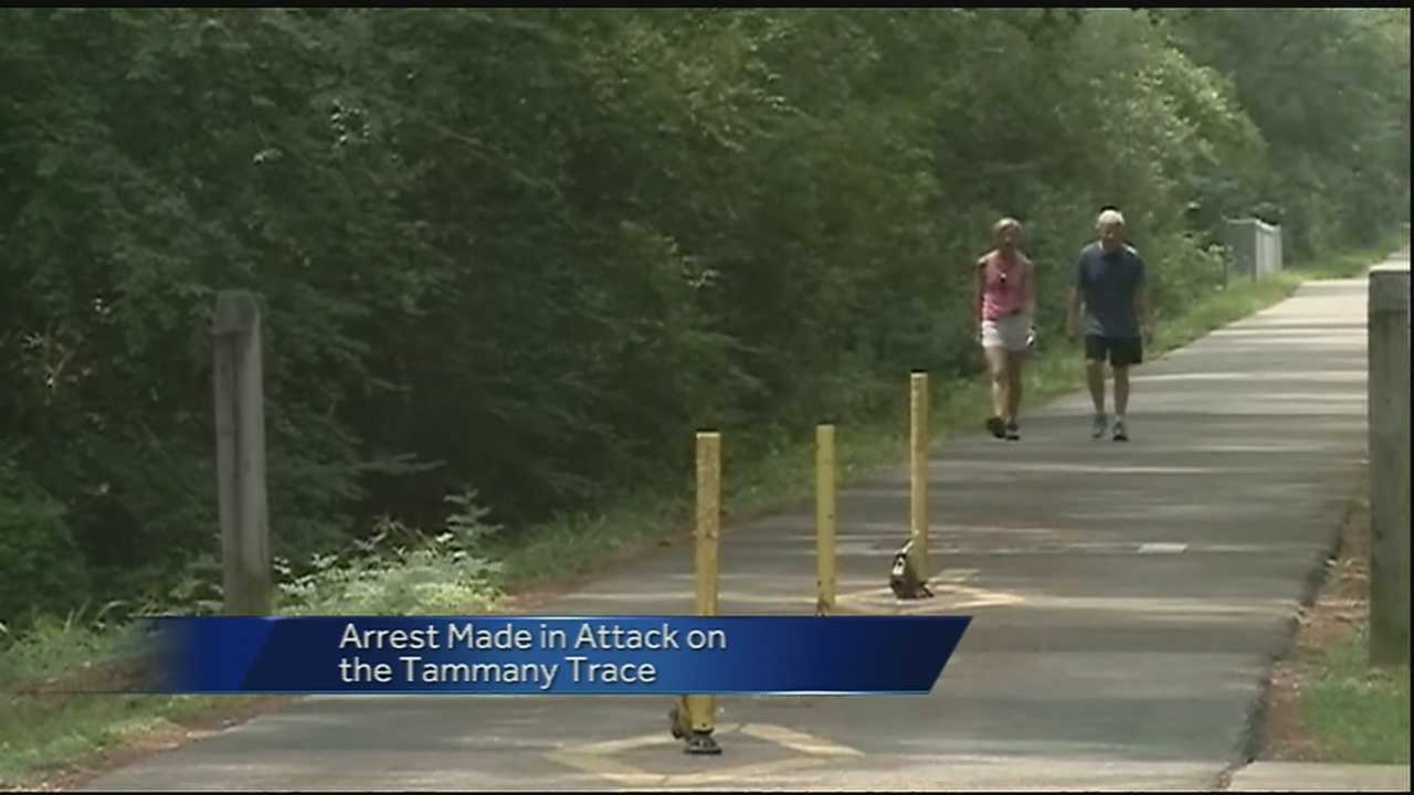 Authorities arrested a man in connection with an attack on the St. Tammany Trace on Wednesday.