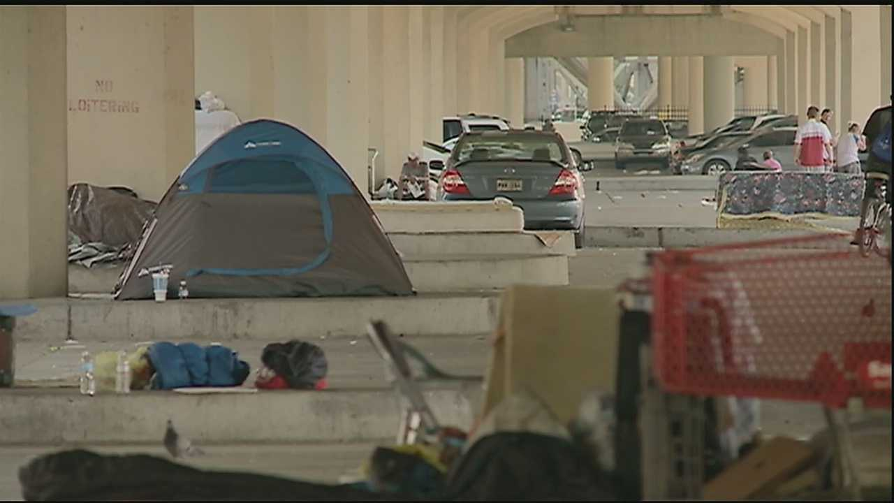 Underneath the expressway, a growing population of tents, mattresses and camps can be easily seen. The letter handed out Monday night informed the homeless squatting there to pack up and move out within 72 hours, citing a public health hazard.