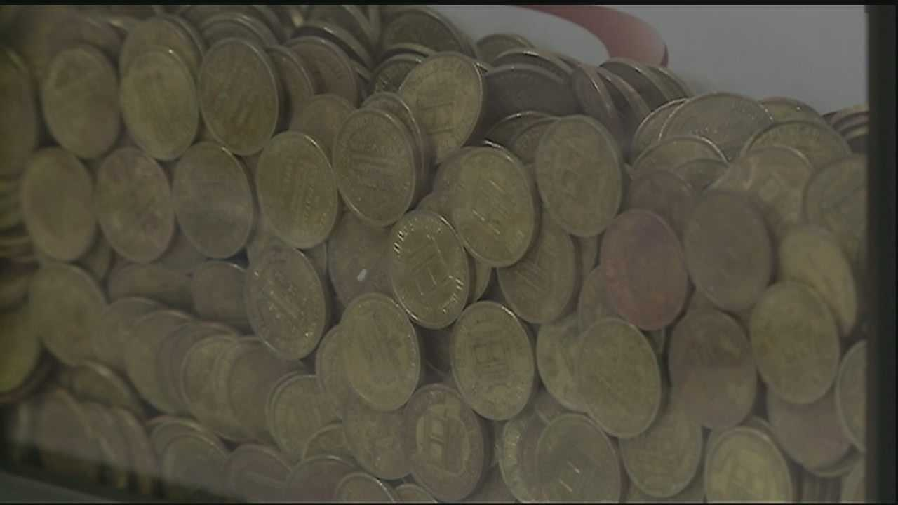 Ten thousand dollars worth of RTA public transit tokens, sitting idle in a vault before Hurricane Katrina, were discovered in a Capital One Bank.