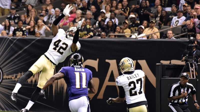 Pierre Warren leaps to make an interception in the final Saints pre-season game of 2014.