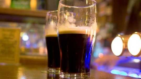 Beer-around-the-world---two-pints-of-Guinness-stout-beer-on-bar.jpg