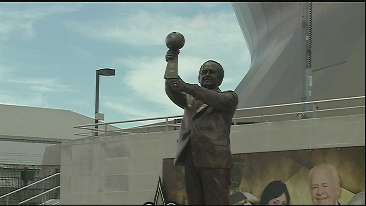The statue features Benson holding the Lombardi Trophy, which was won by the Saints in February 2010 at Super Bowl XLIV.