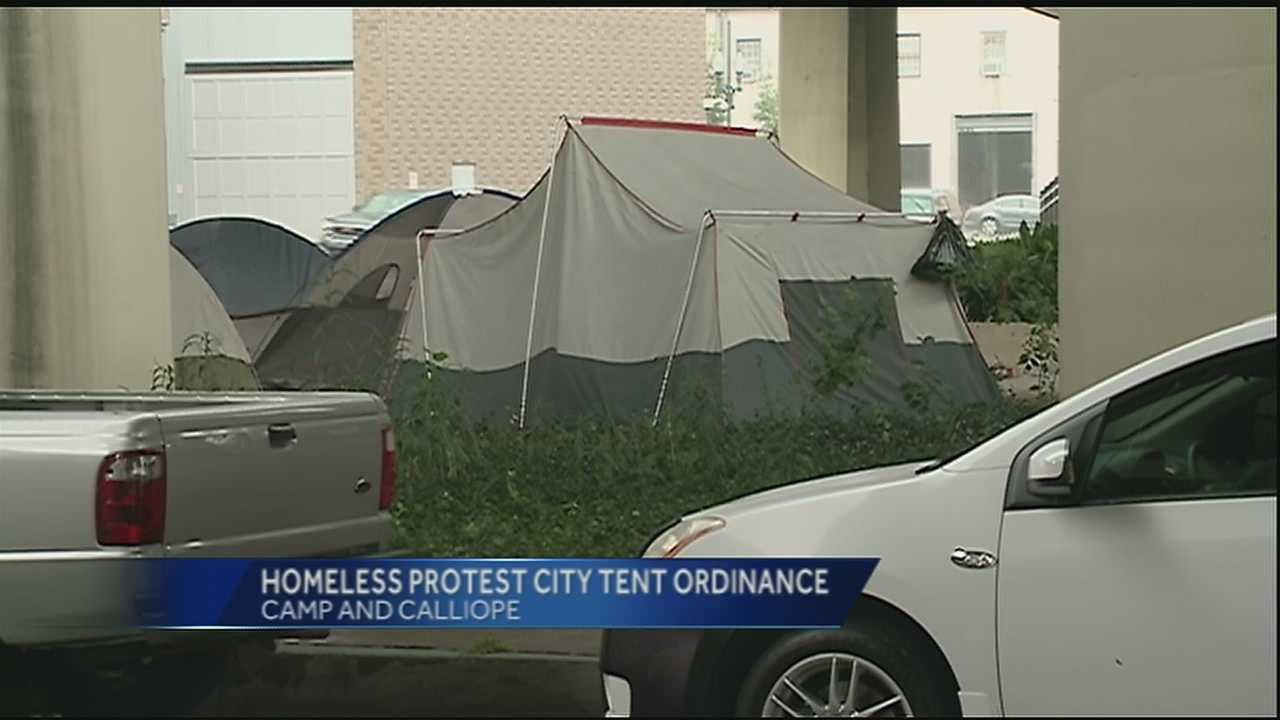 Homeless men and women gathered underneath the Pontchartrain Expressway to protest the new city ordinance against the use of tents and couches in public areas.