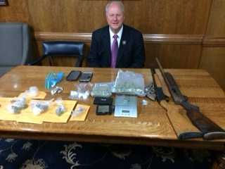 Several cases of beer and numerous cartons of cigarettes were in the residence. One shotgun, one rifle and a .357 magnum revolver were also seized.