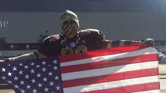 A Saints Superfan was asked to remove the American flag he hung from a railing during Sunday's game