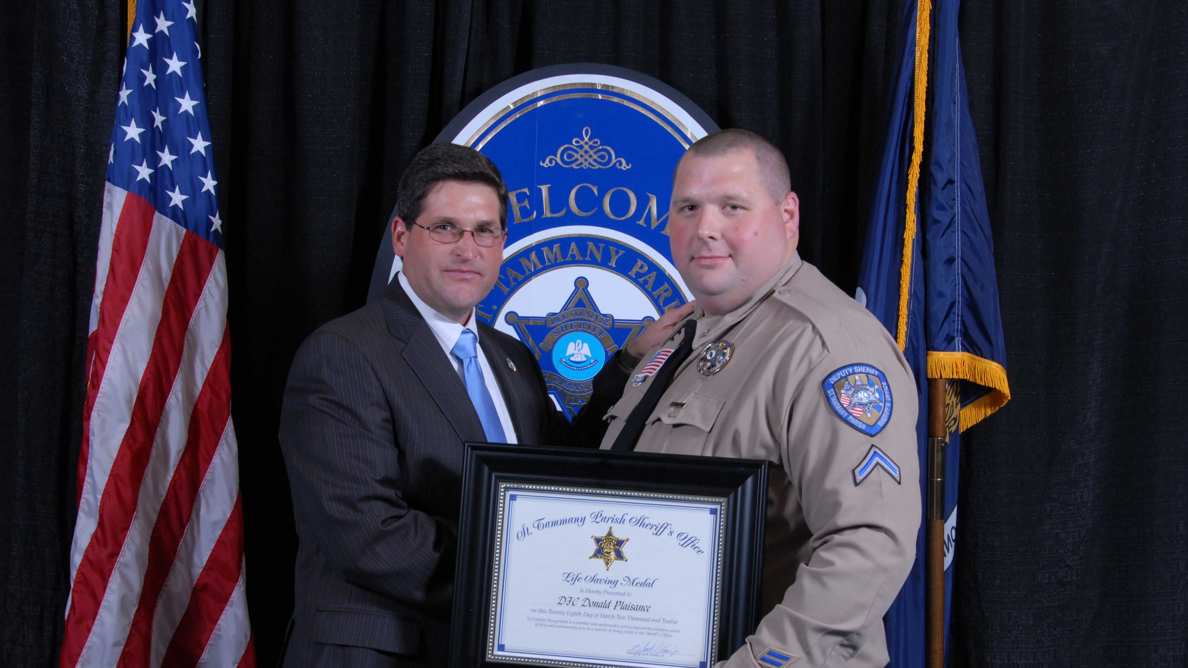 St. Tammany Parish Sheriff Jack Strain and Deputy First Class Donald A. Plaisance, Jr.DFC Donald Plaisance with Sheriff Strain after receiving our Life Saving Award in 2012. During that incident (on Christmas morning, 2011) DFC Plaisance performed CPR on a man who had no vital signs and resuscitated him.