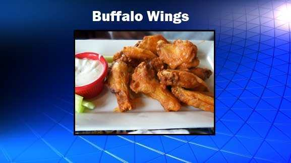 Stick with the buffalo wings. Otherwise you'll take in more than a day's calories with a plate of nachos. Use that blue cheese sauce sparingly though! Source: Health.com