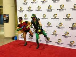 Robin and Arrow from the DC universe pose for photos.