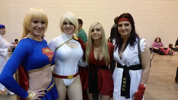 Cosplayers representing Supergirl, Powergirl, Ken and Ryu.