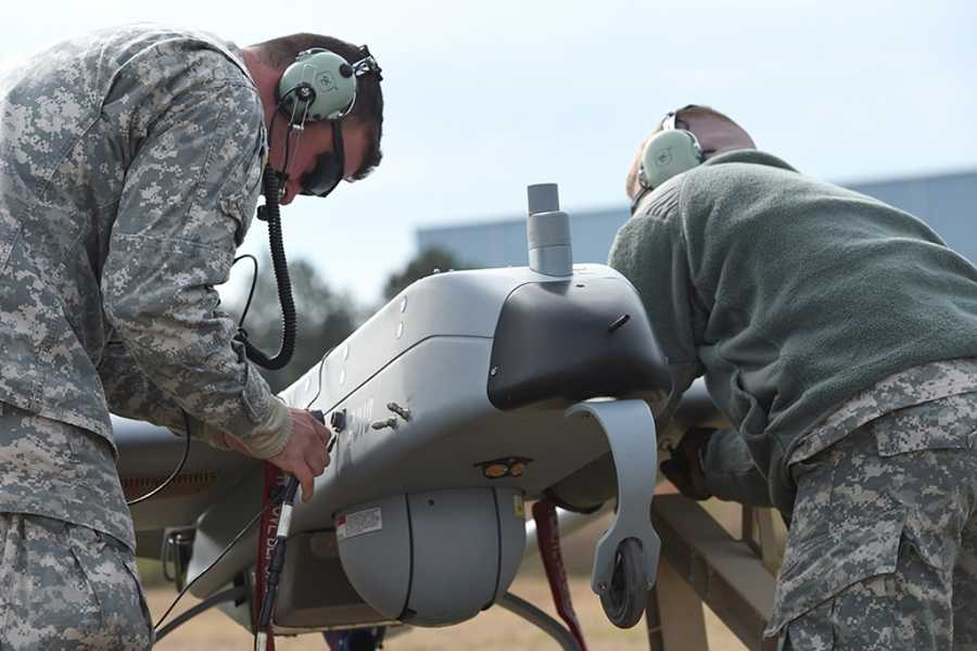 Louisiana Army National Guard Spc. Jordon Giglio and Sgt. Todd Pomier with the 256th Infantry Brigade Combat Team based in Fort Polk, Louisiana, service a RQ-7B Shadow unmanned aerial vehicle during a training exercise, Dec. 17, 2014, at the Tactical Unmanned Aircraft Systems Operations Facility (TUASOF) at Fort Polk Joint Readiness Training Center. The unit supports every type of unit in the Army that comes through JRTC including conventional brigade combat teams, Special Operations Forces and U.S. Air Force and Navy units. The TUASOF also provides UAS specific training for other National Guard unmanned aerial surveillance platoons.