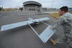 Louisiana Army National Guard Spc. Jordon Giglio with the 256th Infantry Brigade Combat Team based in Fort Polk, Louisiana, pushes a RQ-7B Shadow unmanned aerial vehicle back to its hanger after completing a training mission, Dec. 17, 2014, at the Tactical Unmanned Aircraft Systems Operations Facility (TUASOF) at Fort Polk Joint Readiness Training Center. The TUASOF's primary mission is to support the Joint Readiness Training Center and Fort Polk.