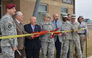 The Official Party prepares to cut the ceremonial ribbon signifying the official opening of the new Tactical Unmanned Aircraft Systems Operations Facility (TUASOF) during a ceremony at Fort Polk in Leesville, Louisiana, on Jan. 13, 2015. The building consists of nearly 10,000 square feet&#x3B; it sits on 11.5 acres and includes a 1,200 foot UAS runway.